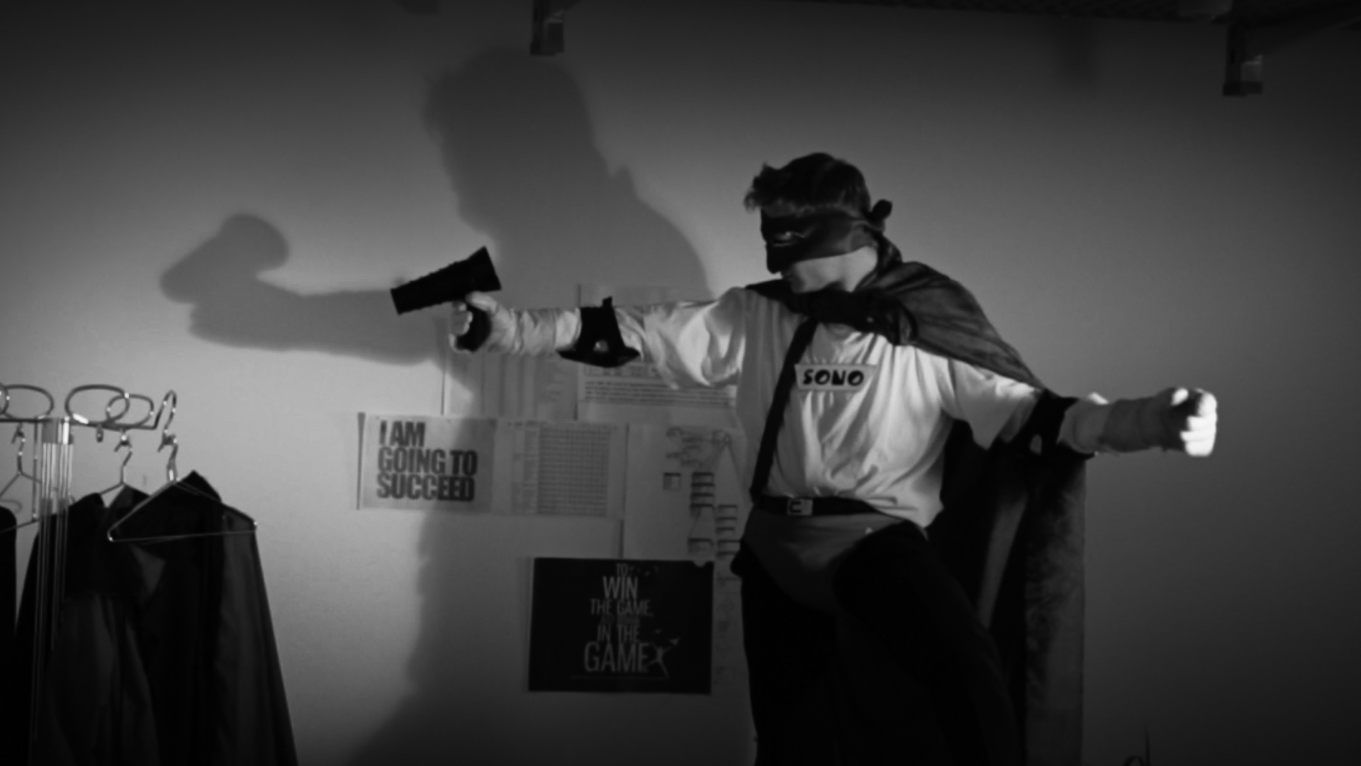 A still image from the clip. The user is now a superhero and pointing the SONO at his surroundings.